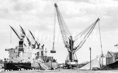 A bulk freight ship is unloaded at the Port of Providence, RI.