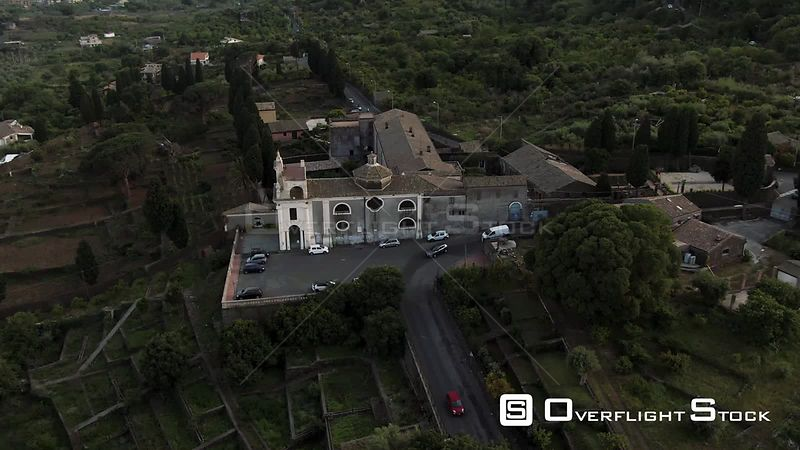Aerial orbiting view of the hermitage of Sant Anna on the slopes of mount Etna in Sicily. Italy