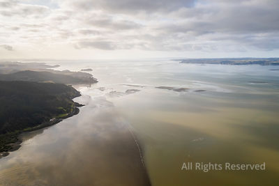 Aerial View on the Kaipara Harbour Mudflats Close to Ruawai, New Zealand. This Is a Morning Scene on a Sunny Day With a Few C...