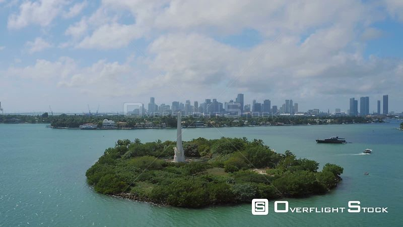 Miami Florida Flying over Flagler Memorial Island with cityscape views.