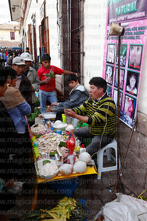 Man demonstrating skin treatments made from natural products, Cusco, Peru