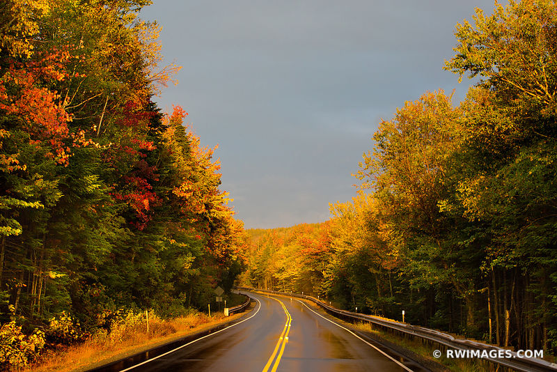 AUTUMN SUNSET DRIVING KANCAMAGUS HIGHWAY NEW HAMPSHIRE FALL COLORS