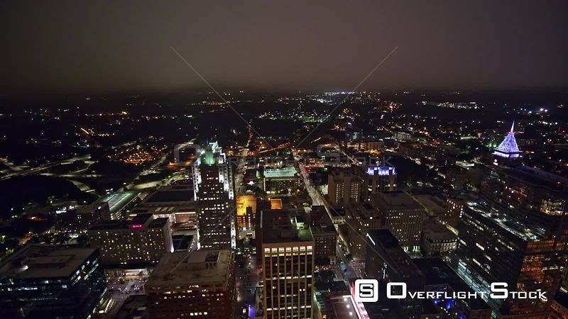 North Carolina Raleigh Aerial Panning cityscape night view with fog near downtown