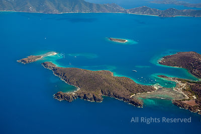 Little Jost Van Dyke and its reef; To the left Green Cay and Sandy Cay in the background. British Virgin Islands Caribbean