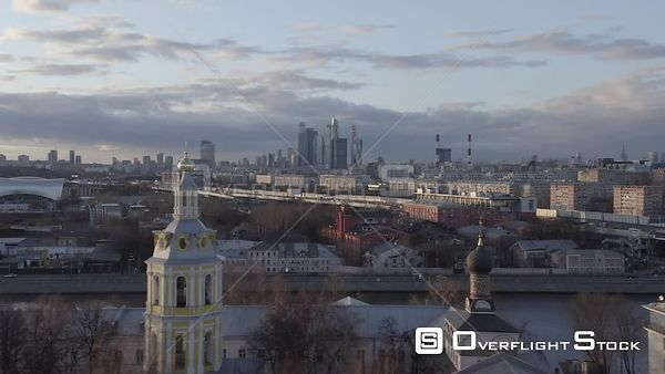 Sideway Flight With Orthodox Churches in Foreground and Moscow City Skyscrapers, During the Sunset. Moscow Russia Drone Video...