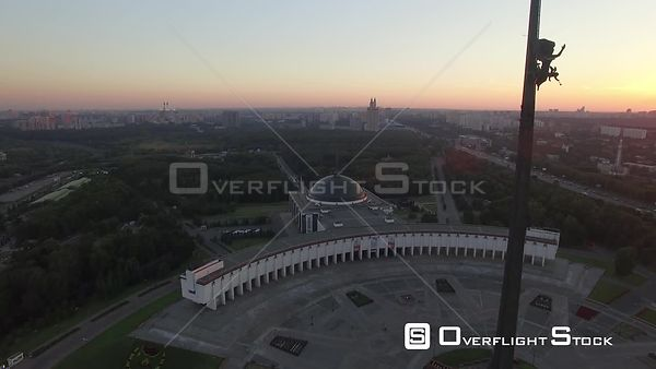 Sunset Flight Pass the Monument at Victory Park in Moscow, Wide Angle. Moscow Russia Drone Video View