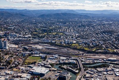 Aerial view of Kelvin Grove with Newstead in the foreground and Mount Nebo in the background.