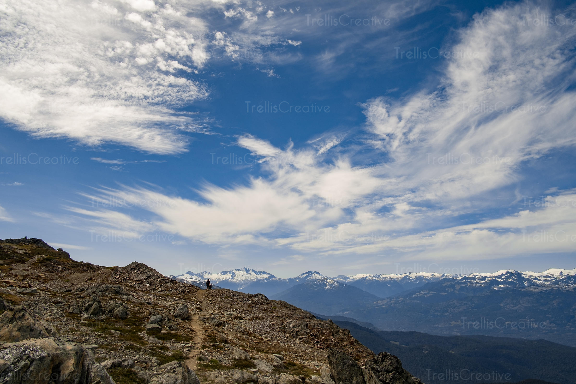 Hiker on remote mountain trail, Blackcomb Mountain, Whistler, Canada.
