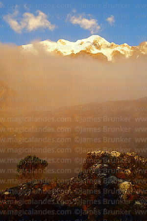 Mist drifts over Laguna Chillata, Pico Schulze (a peak on the west side of the Mt Illampu massif) in background, Bolivia