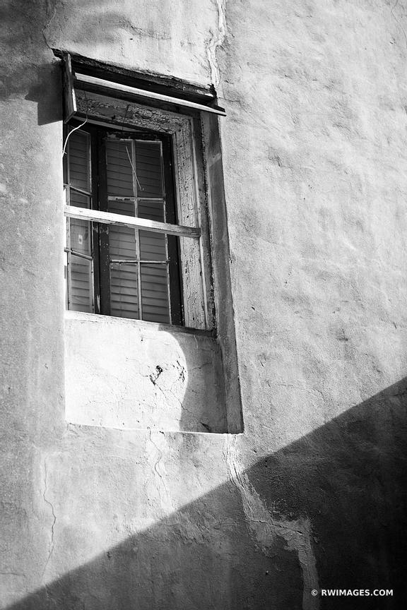 FRENCH QUARTER OLD COURTYARD WALL WITH WINDOW NEW ORLEANS LOUISIANA BLACK AND WHITE VERTICAL