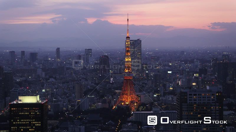 Japan Tokyo Aerial Flying over Shinjuku area towards downtown cityscape views sunset