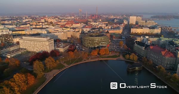 Helsinki cityscape, C4k aerial, drone shot, away from the ympyratalo in Hakaniemi, above elaintarhanlahti, on a sunny autumn ...