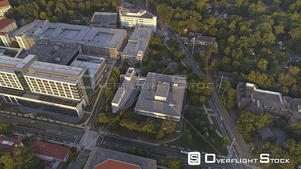 Atlanta Panning birdseye above Emory University Hospital at sunset