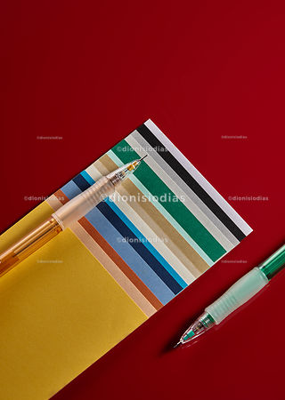 Color paper sample with two pencil.
