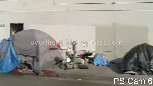 Homeless and Closed Businesses during COVID-19 Pandemic  Los Angeles California USA - Passengers Side View Driving Plate Cam6...