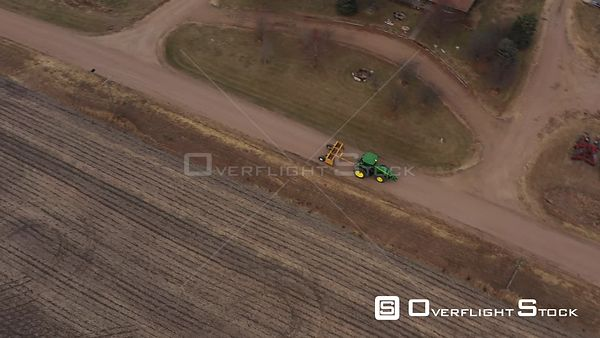 Tracking a Tractor on a Gravel Road, Plymouth, Nebraska, USA