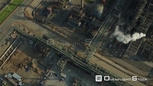 Ventanilla  Peru  Flying low over oil refinery looking down panning up.