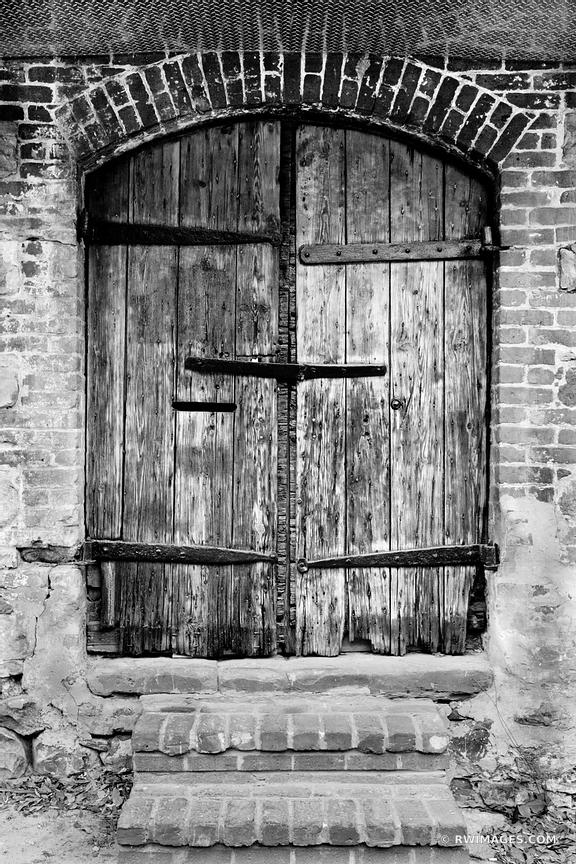 OLD DOOR SAVANNAH HISTORIC DISTRICT NEAR RIVER STREET SAVANNAH GEORGIA BLACK AND WHITE