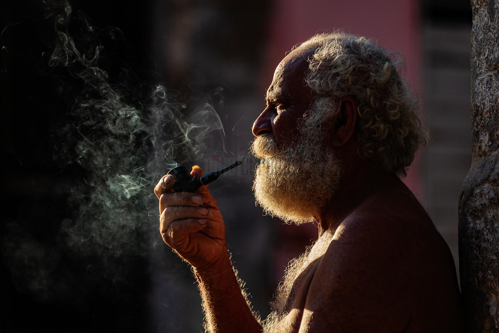 Bearded Man Smoking a Pipe at Dawn
