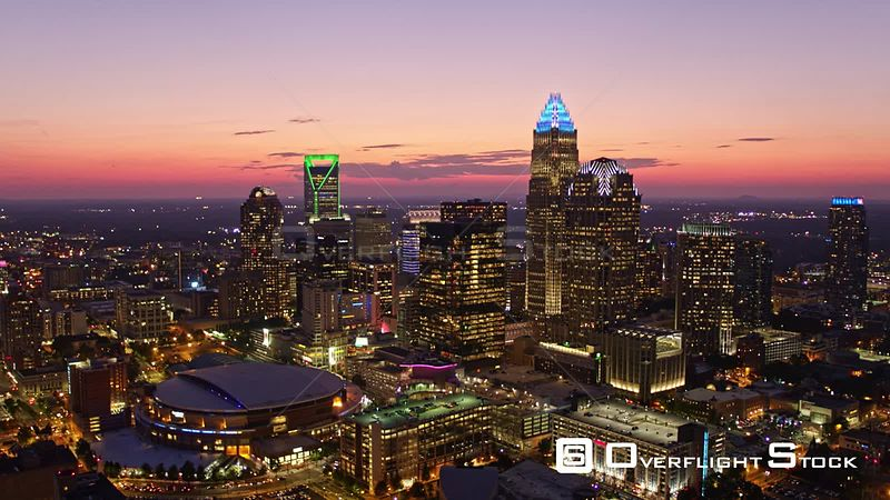 North Carolina Charlotte Aerial Panning around downtown cityscape at sunset dusk
