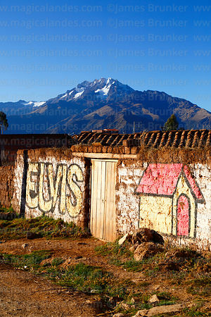 Name of candidate in local elections painted on wall in Racchi, Mt Chicon in background, near Chinchero, Cusco Region, Peru