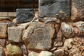 Female face carved on stone in foundations of Santa Ana church, Cusco, Peru