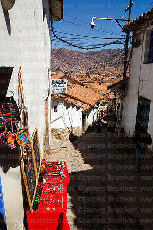 Handicraft stall on colonial street in San Blas district, Cusco, Peru