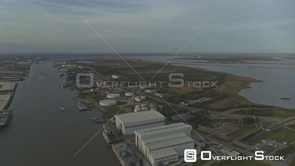 Mobile Alabama Flying over industrial river area with downtown cityscape views at sunset