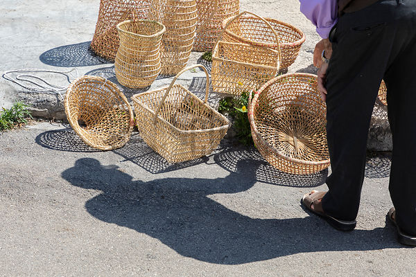 A basket Weaver puts out his Products for Sale