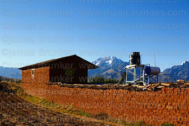 Typical adobe house, water tank and solar powered heater, Mt Chicon in background, Racchi, near Chinchero, Cusco Region, Peru