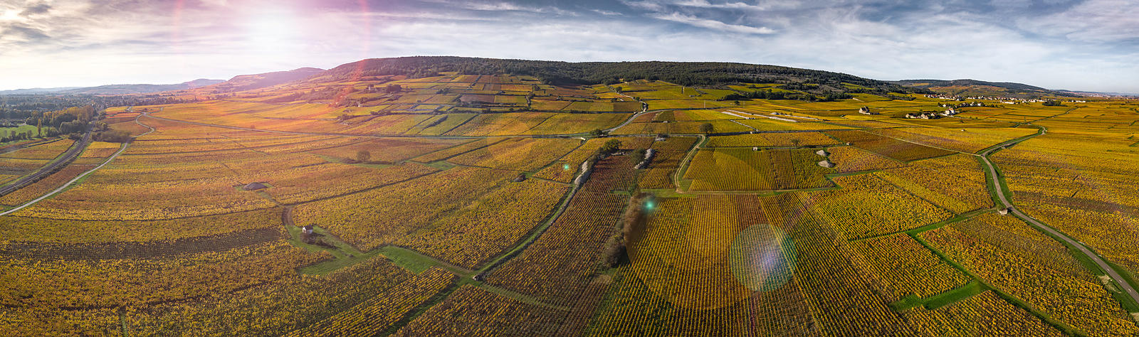 Amazingly beautiful aerial panoramic photo of the colorful autumn vineyards of Burgundy, France.