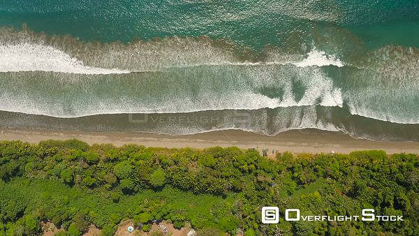 Vertical shot looking down over jungle, beach and ocean. Costa Rica
