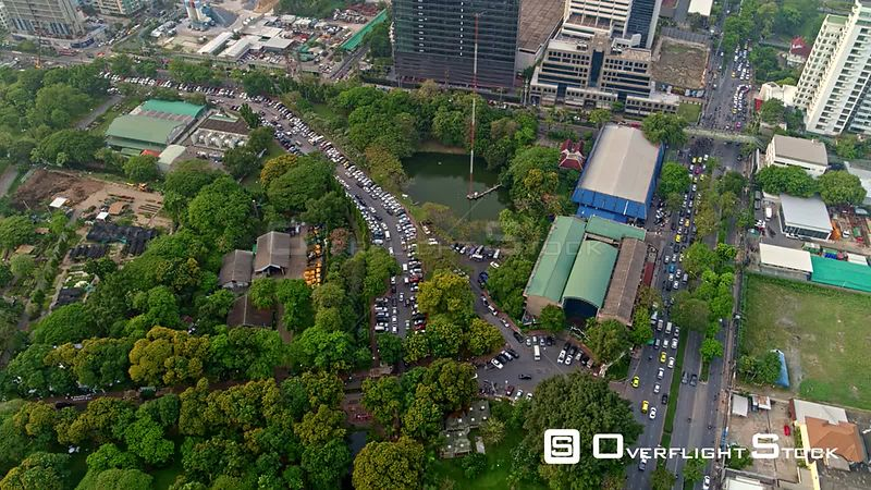 Thailand Bangkok Aerial Flying overhead Lumphini Park rotating around over traffic