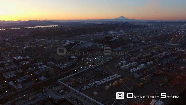 Seattle Washington State USA Flying over shipyard panning left with industrial and cityscape views at dawn