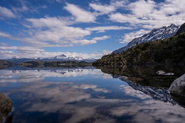 Elevated view of mountains and clouds reflected in lake, Torres del Paine National Park, Last Hope Province, Magallanes Regio...