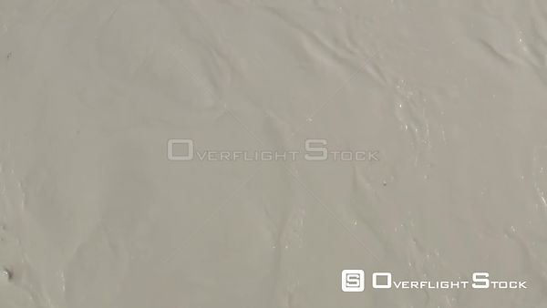 Drone Video Muddy River from Permafrost Melt and Hills Sloughing Off Alaska