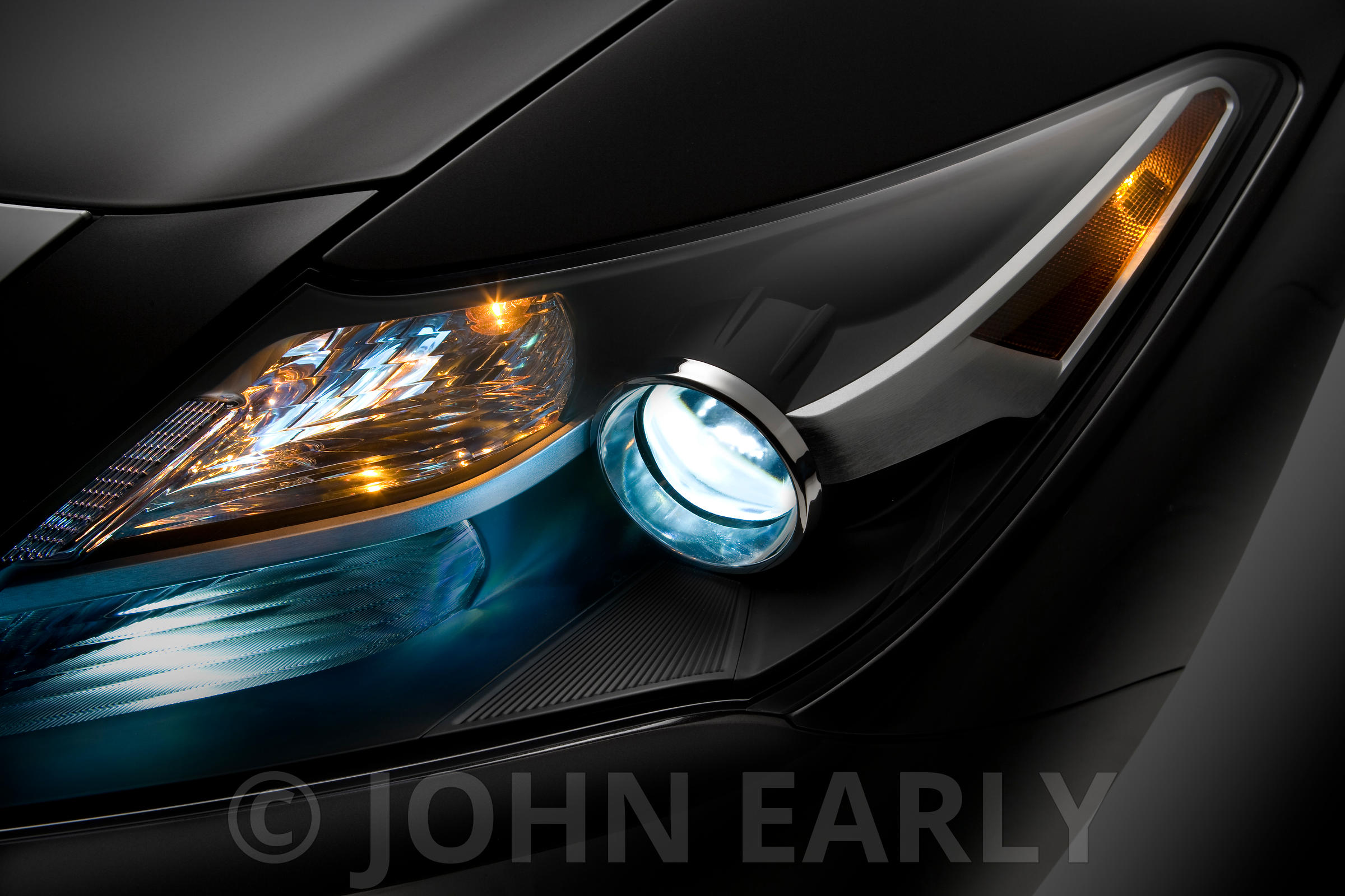 Moody LED Headlight Detail on a Black Car