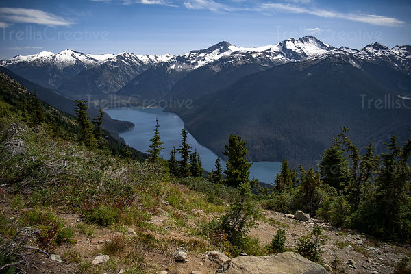 High angle view of mountain lake and snow capped mountains, Blackcomb Mountain, Whistler, Canada.