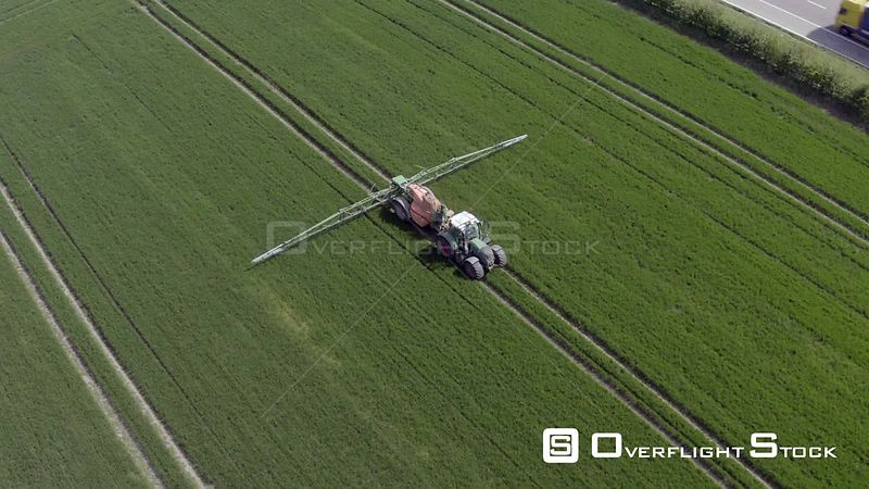 Farm Machinery Spraying Glyphosate Herbicide on Farm Crop.