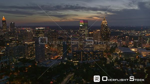 Atlanta Quick reverse panning mid vantage downtown and midtown cityscape view at dusk