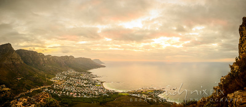 Panoramic view of Camps Bay and the Twelve Apostles from Lion's Head, golden yellow sunset light