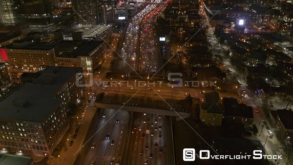 Atlanta Low to high panoramic with freeway traffic and downtown skyline cityscape at night