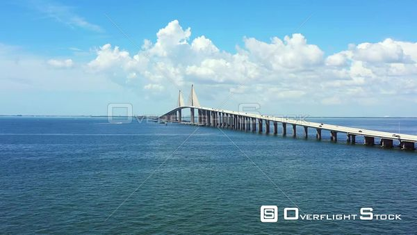 Aerial lateral flyover Sunshine Skyway Bridge over Tampa Bay FL USA