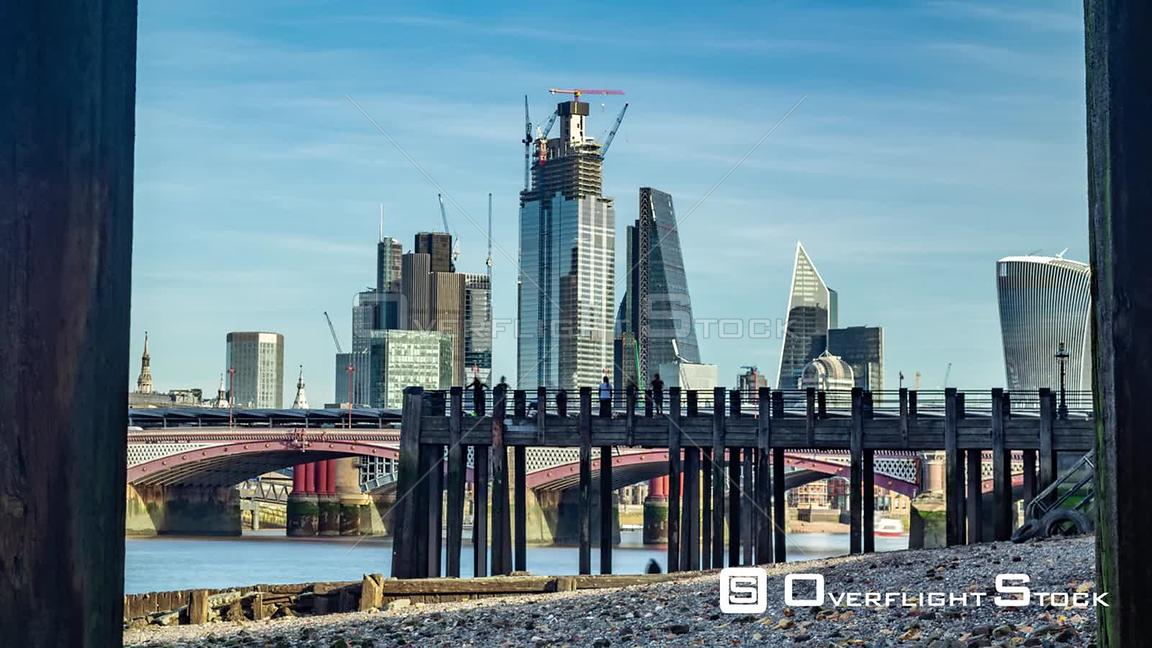 Timelapse zoom out view of the skyline of the City of London framed across the river Thames