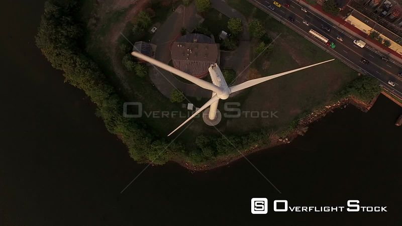 Large wind turbine and industrial plant panning up. Boston Massachusetts