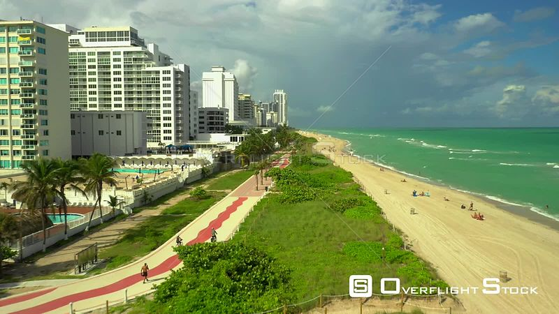 Bike riding on the Atlantic Greenway Miami Beach shot with aerial drone 4k