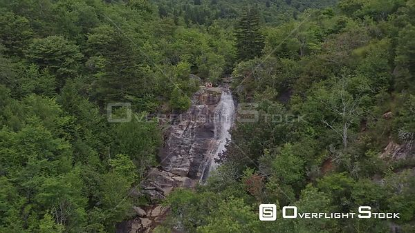 North Carolina Mountains East Fork' Blue Ridge Upper Falls from close up reversing with views from afar with seated couple