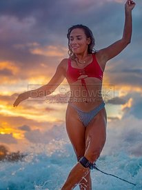 Girl Surfing At Sunset