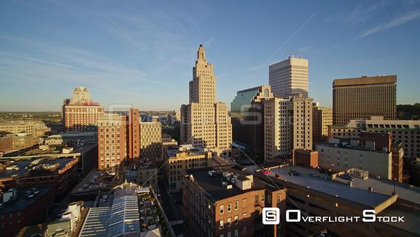 Providence Rhode Island Flying through downtown cityscape toward Capitol, low sunrise vantage