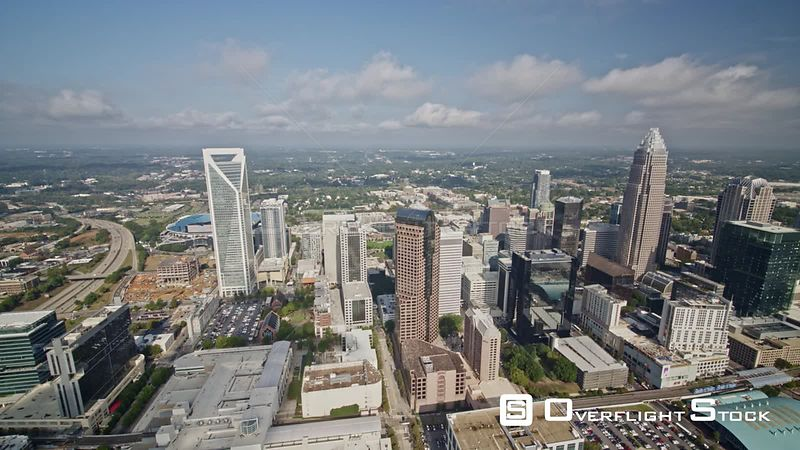 North Carolina Charlotte Aerial Birdseye flying in reverse looking over downtown
